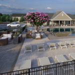The resort-style heated outdoor pool is surrounded by comfortable chaise lounges for the perfect day at home.